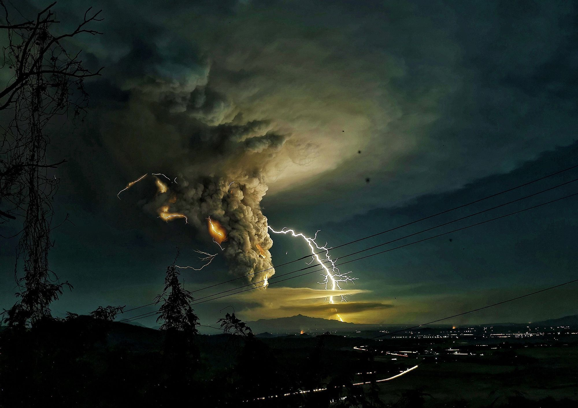 Lightning strikes over Batangas as Taal volcano erupts in the Philippines.